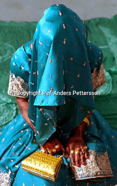 dicotanz00003 .Tanzania. An unidentified bride waiting for her husband to be in a house on October 6, 2002 in Zanzibar Town on Zanzibar, Tanzania. Zanzibar is mainly Muslim and the woman is entering a traditional wedding. .©Per-Anders Pettersson/iAfrika Photos