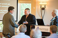 The North Hennepin Area Chamber of Commerce held its annual members meeting at the Edinborough Golf Course in Brooklyn Park, MN. Event photography by Minneapolils Commercial and Corporate Event Photographer Justin Cox