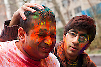 A man shuts his eyes after being covered with colored powder during the Holi Hai festival organized by Indian community in New York City March 31, 2013. Photo by Eduardo Munoz Alvarez / VIEWpress.