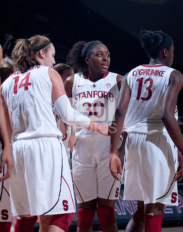 STANFORD, CA - January 22, 2011: Kayla Pedersen, Nnemkadi Ogwumike and Chiney Ogwumike of the Stanford women's basketball team during Stanford's game against USC at Maples Pavilion. Stanford beat USC 95-51.