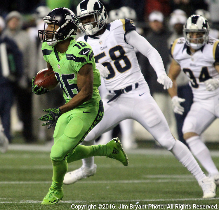 Seattle Seahawks wide receiver Tyler Lockett (16) runs back a kickoff for 27-yards against the Los Angeles Rams at CenturyLink Field in Seattle, Washington on December 15, 2016.  The Seahawks beat the Rams 24-3.  ©2016. Jim Bryant Photo. All Rights Reserved