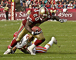 San Francisco 49ers running back Garrison Hearst (20) gets away from Kansas City Chiefs defensive back Ray Crockett (39) for big run on Sunday, November 10, 2002, in San Francisco, California. The 49ers defeated the Chiefs 17-13.