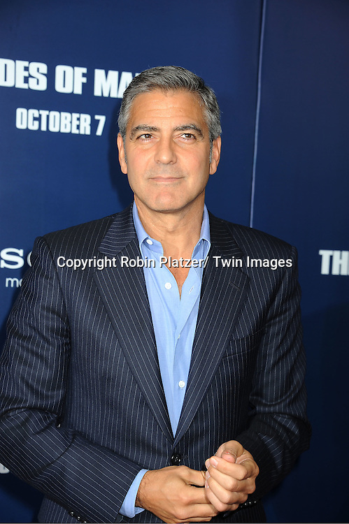 "George Clooney attends the New York Premiere of ""The Ides of March"" ..on October 5, 2011 at The Ziegfeld Theatre in New York City. The movie stars George Clooney, Marisa Tomei, Evan Rachel Wood, Paul Giamatti, Phillip Seymour Hoffman and Jeffrey Wright."
