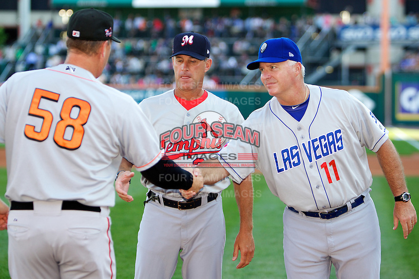Las Vegas 51s manager Marty Brown #11 and pitching coach Blaise Ilsley #30 of the Memphis Redbirds greet hitting coach Russ Morman #58 before the Triple-A All-Star game featuring the Pacific Coast League and International League top players at Coca-Cola Field on July 11, 2012 in Buffalo, New York.  PCL defeated the IL 3-0.  (Mike Janes/Four Seam Images)