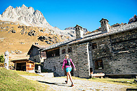 A trail runner passing through Grevasalvas, near Maloja, in the Engadin, while on a running tour to Piz Lunghin. Switzerland.