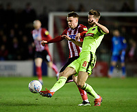 Lincoln City's Jake Hesketh vies for possession with  Bolton Wanderers' Luke Murphy<br /> <br /> Photographer Chris Vaughan/CameraSport<br /> <br /> The EFL Sky Bet League One - Lincoln City v Bolton Wanderers - Tuesday 14th January 2020  - LNER Stadium - Lincoln<br /> <br /> World Copyright © 2020 CameraSport. All rights reserved. 43 Linden Ave. Countesthorpe. Leicester. England. LE8 5PG - Tel: +44 (0) 116 277 4147 - admin@camerasport.com - www.camerasport.com