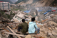 Residents search for signs of trapped life on collapsed buildings in Beichuan, Sichuan, China on 15 May 2008. China now estimates the death toll to be around 50,000 as prospects of survival for those still buried diminishes.