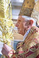 Pope Benedict XVI holds a woven palm frond while celebrating an open-air Palm Sunday mass in St. Peter's square at the Vatican Sunday, April 5, 2009.