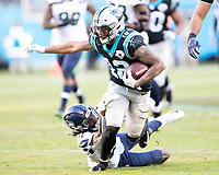 CHARLOTTE, NC - DECEMBER 15: D.J. Moore #12 of the Carolina Panthers is tackled by Tre Flowers #21 of the Seattle Seahawks during a game between Seattle Seahawks and Carolina Panthers at Bank of America Stadium on December 15, 2019 in Charlotte, North Carolina.