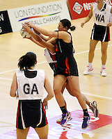 29.09.2014 Counties Manukau's Leatiana Shelford and Eastern Waikato's Carissa Te Wharau in action during the  Counties Manukau v Eastern Waikato duing the Lion Foundation Netball Champs at the Trusts Stadium in Auckland. Mandatory Photo Credit ©Michael Bradley.
