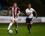 Paul Coutts of Sheffield Utd gets clear of Antonee Robinson of Bolton Wanderers during the Championship match at the Macron Stadium, Bolton. Picture date 12th September 2017. Picture credit should read: Simon Bellis/Sportimage