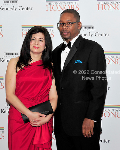 Ravi Coltrane and Kathleen Hennessy arrive for the formal Artist's Dinner honoring the recipients of the 2011 Kennedy Center Honors hosted by United States Secretary of State Hillary Rodham Clinton at the U.S. Department of State in Washington, D.C. on Saturday, December 3, 2011. The 2011 honorees are actress Meryl Streep, singer Neil Diamond, actress Barbara Cook, musician Yo-Yo Ma, and musician Sonny Rollins..Credit: Ron Sachs / CNP