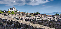 Fine Art Landscape Print Photograph of the architectural ruins in Pompeii, near the city of Naples, Italy.<br /> This dramatic photograph depicts the dramatic expanse and devastation that occurred in Pompeii. The textures on the rocks and the dramatic lighting effect of the clouds further emphasize this dramatic moment in history.