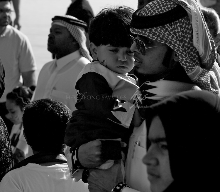Local family crowds on the National Day of Qatar. Doha, Qatar | Dec 10