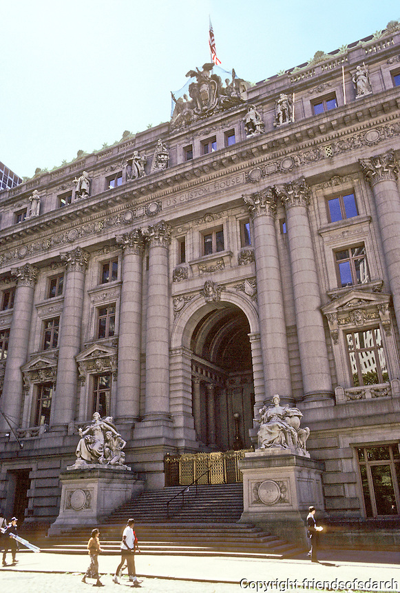New York: U.S. Customs House, 1907. Cass Gilbert, Architect. Beaux Arts style. Daniel Chester French, sculpted the Four Continents in front of building. Saved from demolition and is on National Register of Historic Preservation 1972.  Restored and houses National Museum of American Indian and a Bankruptcy Court. Photo '91.