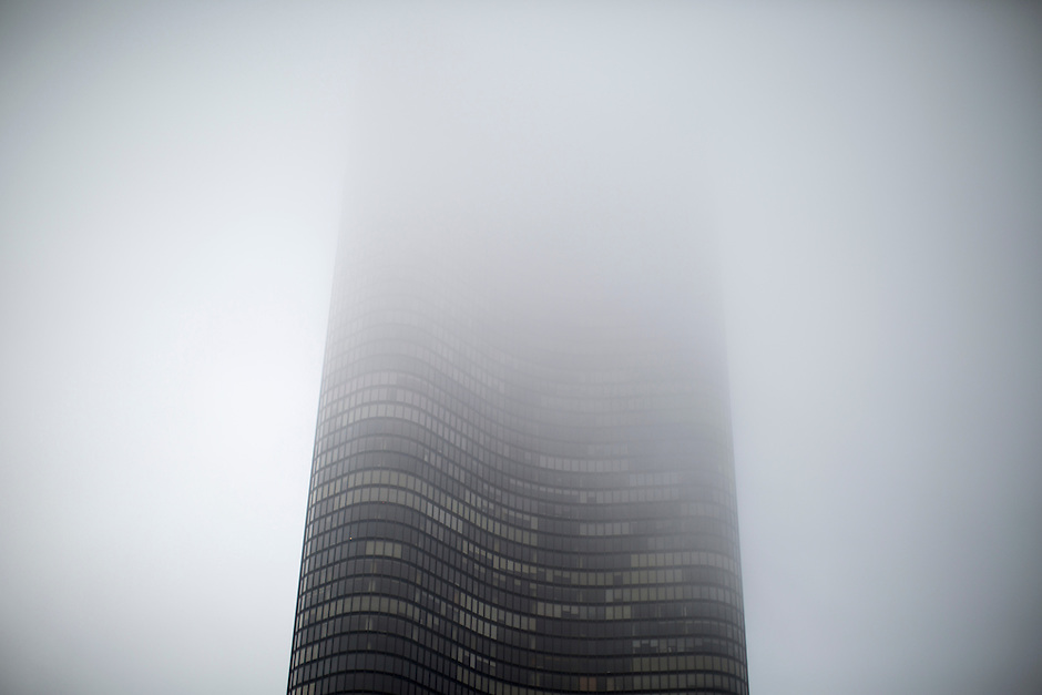 Buildings emerge from the fog on Sunday, Aug. 30, 2015, in Chicago. (Photo by James Brosher)