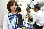 July 30, 2010 - Tokyo, Japan - A Love Doll is used as a staff employee to hold and distribute pamphlets during Robotech at Tokyo Big Sight, Japan, on July 30, 2010. The exhibition on the service robot fabrication techniques promotes technology exchange and cooperation.
