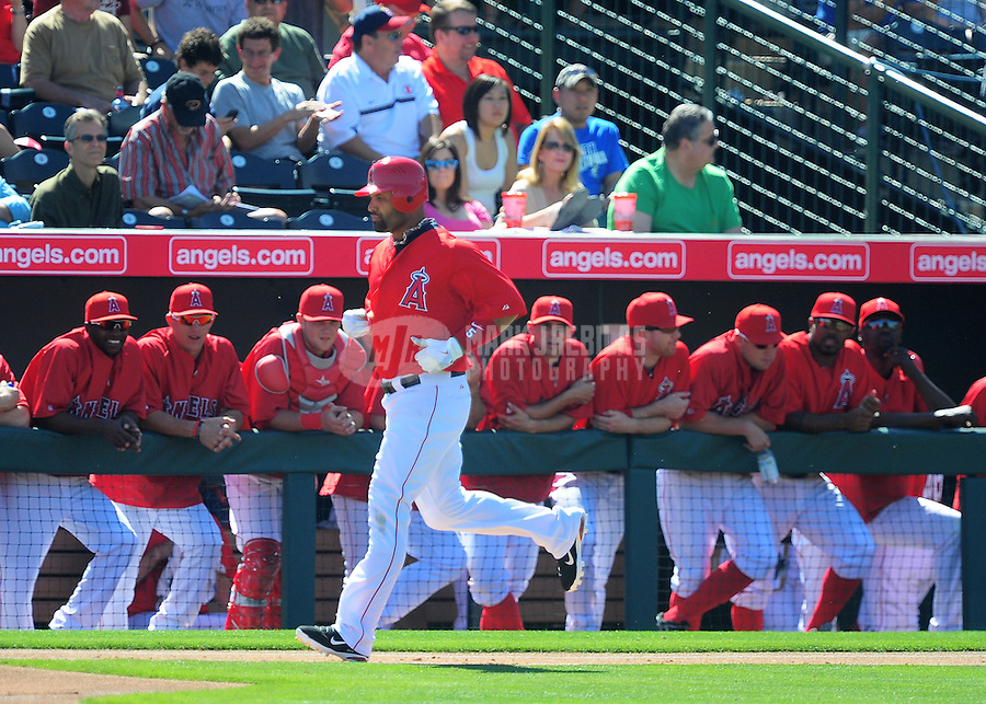 Mar. 6, 2012; Tempe, AZ, USA; Los Angeles Angels designated hitter Albert Pujols runs to first base after walking in the first inning against the Chicago White Sox during a spring training game at Tempe Diablo Stadium.  Mandatory Credit: Mark J. Rebilas-