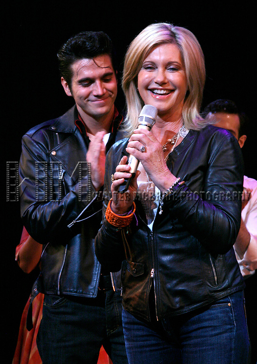 Olivia Newton-John is headed back to Rydell High to promote Breast Cancer Awareness after the Curtain Call for GREASE at the Brooks Atkinsoon Yheatre in New York City. <br />October 7, 2008<br />( pictured: Olivia Newton John, Derek Keeling )