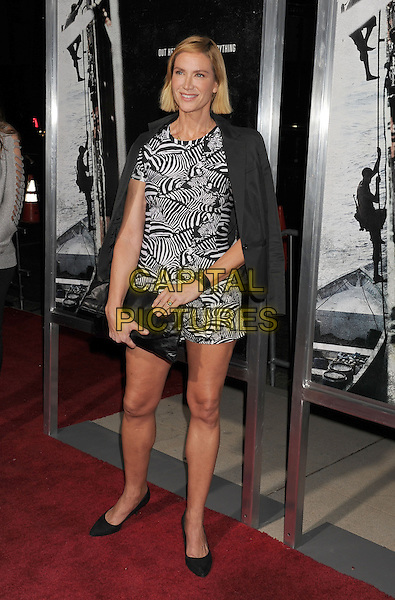 Kelly Lynch<br /> Premiere of &quot;Captain Phillips&quot; held at the Academy of Motion Picture Arts and Sciences, Beverly Hills, California, USA.<br /> September 30th, 2013<br /> full length black white pattern playsuit clutch bag jacket over shoulders <br /> CAP/ROT/TM<br /> &copy;Tony Michaels/Roth Stock/Capital Pictures