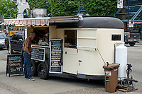 Man ordering lunch from a food truck in downtown Vancouver, BC, Canada