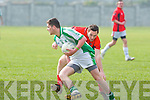 Na Gaeil's Rob Murphy and Fossa's Kenneth Clifford...
