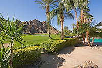 View of Golf Course with dramatic mountains close by