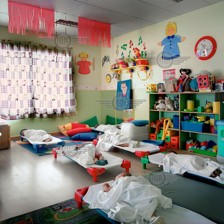 Resting time for babies in the kindergarten of Soto del Real prison. More than 200 women live with their children in Spanish jails. Children can live with their mothers in prison up to the age of three.