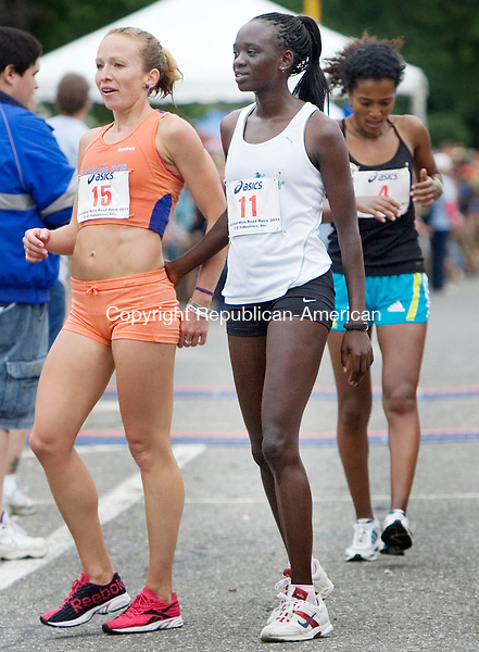 LITCHFIELD, CT. 12 June 2011-061211SV06--Finishing for the women, from left, Esther Erb of Blowing Rock, NC. finishes 2nd, Pasca Cheriuyot of Kenya and training in Tallahassee, FL. finishes 1st, and Serkalem Abrha of Ethiopia and training in Bronx, NY. finished 3rd  during the 35th annual Litchfield Hills Road Race in Litchfield Sunday.<br /> Steven Valenti Republican-American