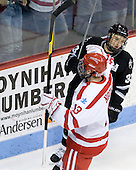 Garrett Noonan (BU - 13) celebrates with a salute. - The Boston University Terriers defeated the visiting Providence College Friars 6-1 on Friday, January 20, 2012, at Agganis Arena in Boston, Massachusetts.