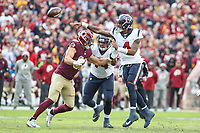 Landover, MD - November 18, 2018: Houston Texans quarterback Deshaun Watson (4) avoids a sack by Washington Redskins outside linebacker Ryan Kerrigan (91) during the  game between Houston Texans and Washington Redskins at FedEx Field in Landover, MD.   (Photo by Elliott Brown/Media Images International)