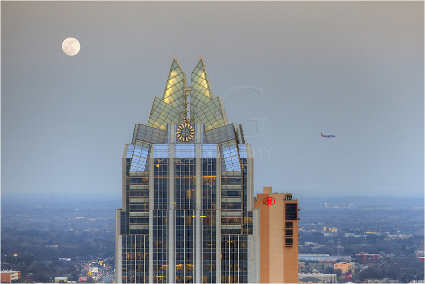 While shooting for the Shores' Condominiums, I noticed the moon rising and the airplanes landing all in the same vicinity. I switched to a telephoto lens and captured a few images. This image of the Frost Tower shows the nearly full moon rising with a Southwest Airlines plane approaching the airport for landing.