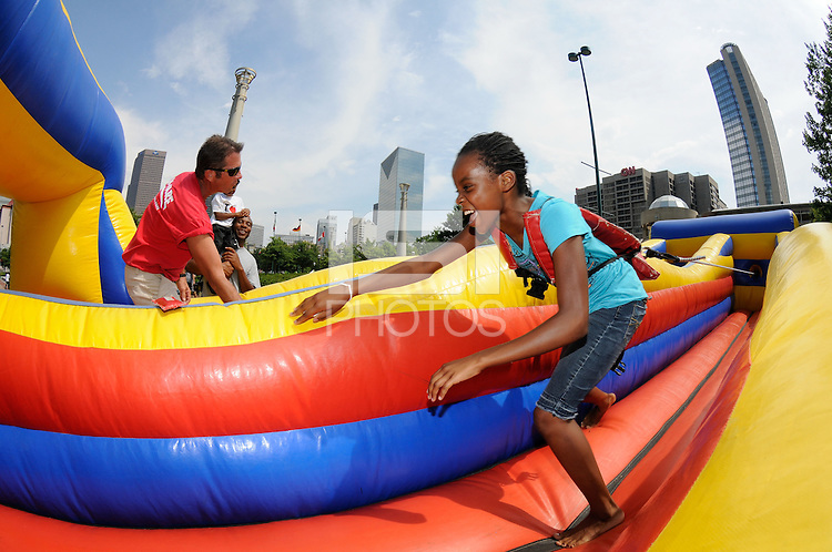 Kids plays on an inflatable during the Women's Professional Soccer (WPS) All-Star Fan Fest at Centennial Olympic Park in Atlanta, GA, on June 28, 2010.