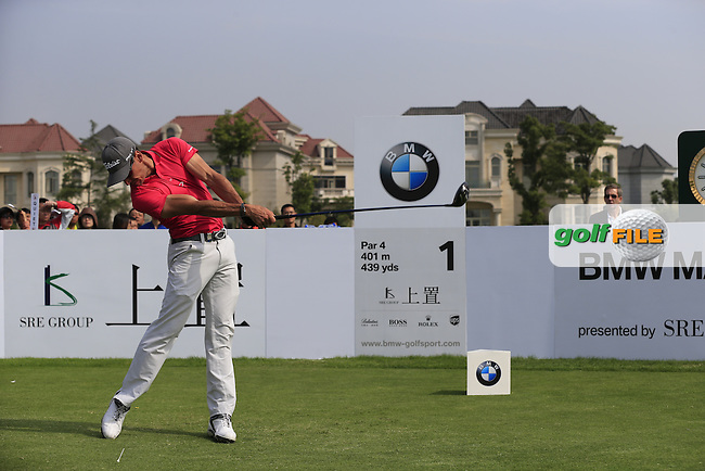Rafael Cabrera-Bello (ESP) tees off the 1st tee to start his match during Sunday's Final Round of the 2013 BMW Masters presented by SRE Group held at Lake Malaren Golf Club, Shanghai, China. 27th October 2013.<br /> Picture: Eoin Clarke/www.golffile.ie