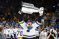 June 12, 2019: St. Louis Blues center Ivan Barbashev (49) hoists the Stanley Cup at game 7 of the NHL Stanley Cup Finals between the St Louis Blues and the Boston Bruins held at TD Garden, in Boston, Mass.  The Saint Louis Blues defeat the Boston Bruins 4-1 in game 7 to win the 2019 Stanley Cup Championship.  Eric Canha/CSM.