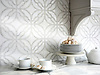 Claudette, a stone waterjet mosaic, shown in polished Afyon White and tumbled Thassos, is part of the Parterre Collection by Paul Schatz for New Ravenna.
