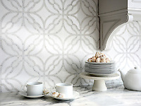 Claudette, a stone waterjet mosaic, shown in polished Afyon White and tumbled Thassos. Designed by Sara Baldwin for New Ravenna.<br />