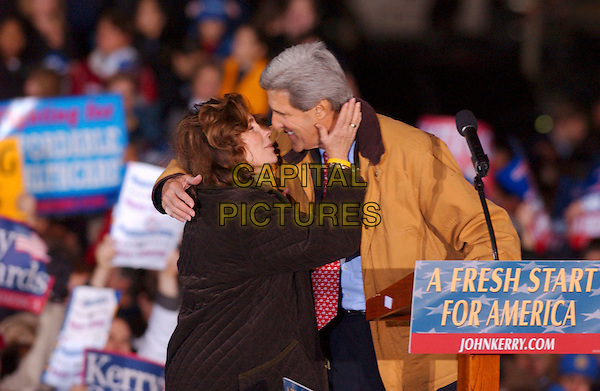 TERESA HEINZ KERRY & JOHN KERRY.Presidential Candidate's wife during an election eve rally held near Cleveland City Hall, Cleveland, Ohio, USA, 1st November 2004..half length speaking speech senator wife husband kissing married.**UK SALES ONLY**.Ref: ADM.www.capitalpictures.com.sales@capitalpictures.com.©Capital Pictures.