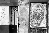 France. Ile de France. Paris. Closed shop. Recession. Graffiti on the paineted windows with a smiling man's profile and a heart . 22.04.17  © 2017 Didier Ruef