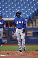 AZL Rangers Rafy Barete (21) waits at home plate after Keyber Rodriguez's fifth-inning home run during an Arizona League game against the AZL Brewers Blue on July 11, 2019 at American Family Fields of Phoenix in Phoenix, Arizona. The AZL Rangers defeated the AZL Brewers Blue 5-2. (Zachary Lucy/Four Seam Images)