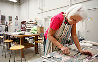NWA Media/DAVID GOTTSCHALK - 12/15/14 -  Nan Yarnelle (cq) presses a pattern into clay dinnerware she is experimenting with Monday December 15, 2014 in the Reinboth (cq) room at the Community Creative Center at the Walton Arts Center's Nadine Baum Studiosin Fayetteville. Yarnelle was working with the different sizes of plates during Open Studio, a self directed time available at the studios.