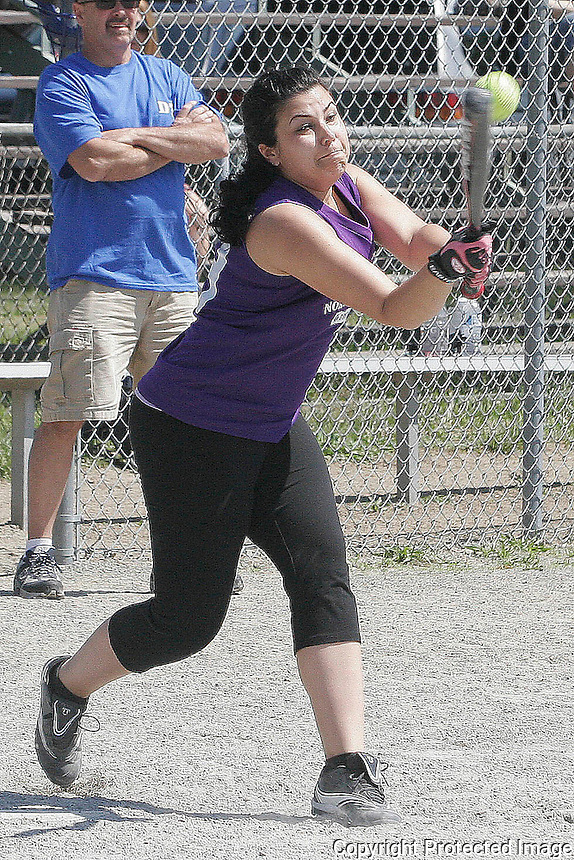 The DMR Construction softball player Heather Baker #29 hits the ball during The DMR Construction vs. Downtown Café game May 20,2012 (Photo by Gary Wilcox)
