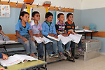 Palestinian children are seen at  Jenba's school in the South Hebron Hills, Jenba a Palestinian town of 50 families seats in an area called by the IDF as &ldquo;Firing Zone 918&rdquo; and is located in the southern Hebron hills near the town of Yatta.  Spread over 30,000 dunams, it includes twelve Palestinian villages.  According to OCHA figures, 1,622 people lived in the area in 2010, and according to local residents the number of inhabitants currently stands at about 1,800. For over a decade, the residents of twelve uniquely traditional Palestinian villages in the area of Masafer-Yatta in the south Hebron hills have lived under the constant threat of demolition, evacuation, and dispossession.<br />
