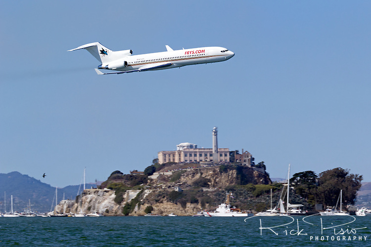 The San Jose Sharks hockey team's aircraft, a Boeing 727 (N724YS) makes a low pass over San Francisco Bay in front of Alcatraz Island
