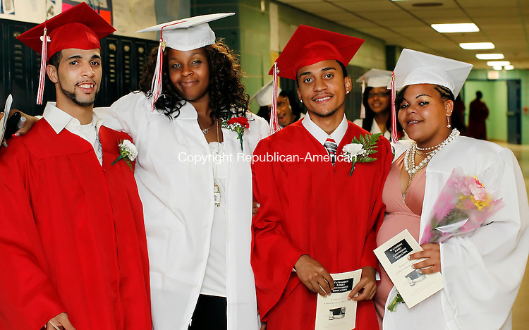 Waterbury, CT-10, June 2010-061010CM11 Graduates pose for a quick photo before the start of the Waterbury Adult Continuing Education graduation, held at Kennedy High School Thursday night.  --Christopher Massa Republican-American