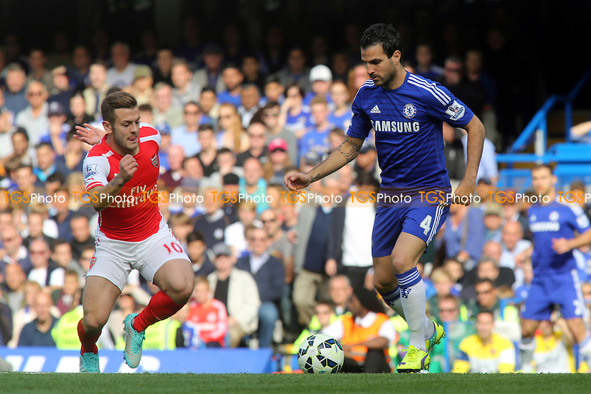 Cesc Fabregas of Chelsea in possession as Jack Wilshere of Arsenal gets ready to make a challenge - Chelsea vs Arsenal - Barclays Premier League Football at Stamford Bridge, London - 05/10/14 - MANDATORY CREDIT: Paul Dennis/TGSPHOTO - Self billing applies where appropriate - contact@tgsphoto.co.uk - NO UNPAID USE
