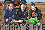 MEASURING: Pa Lucid (Ballyheigue),Jimmy and Jmaie Donegan (Causeway) measuring the burrows at the Ballyheigue Ploughing competition on Sunday on Derek and Micjael O'Driscoll's land,Ballyheigue.