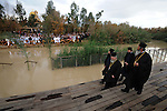 Christian clerics arrive at the baptism site of Qasr el-Yahud on the west bank of the Jordan River, near the West Bank town of Jericho, during Epiphany. Christian pilgrims are seen gathering on the east bank in Jordan.