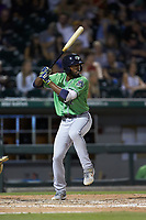 Travis Demeritte (12) of the Gwinnett Braves at bat against the Charlotte Knights at BB&T BallPark on July 12, 2019 in Charlotte, North Carolina. The Stripers defeated the Knights 9-3. (Brian Westerholt/Four Seam Images)