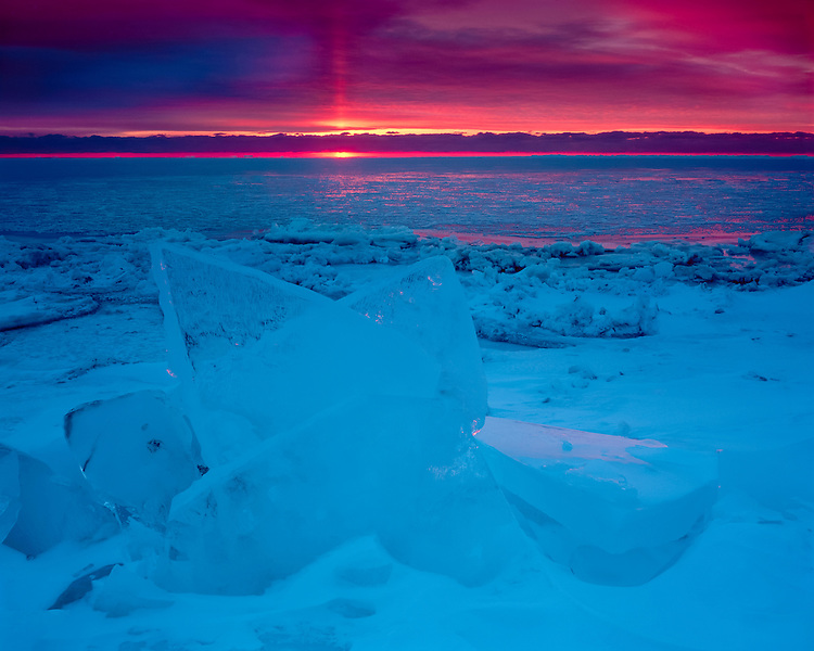 Sunrise light on the frozen shore of Lake Michigan at Newport State Park; Door County, WI